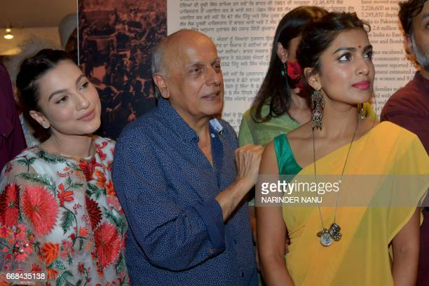 Indian actresses Gauhar Khan and Pallavi Sharda pose with film producer Mahesh Bhatt during a promotional event for the Bollywood film 'Begum Jaan'...