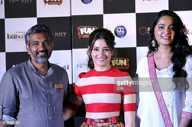 Indian actresses Tamannaah Bhatia and Anushka Shetty attend the trailer launch of their upcoming film 'Baahubali' written and directed by S S...