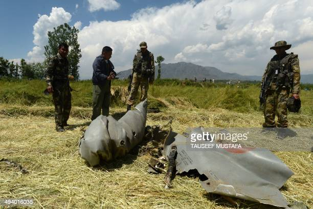 Indian air force and army soldiers look at the wreckage of a MiG21 fighter aircraft of the Indian Air Force which crashed at Marhama Bijbehara...