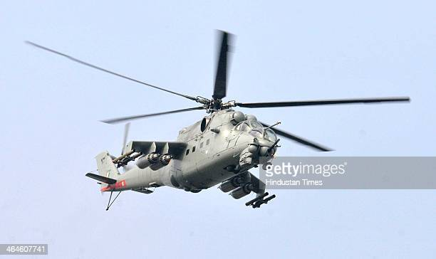 Indian Air Force attack helicopter fly over the saluting base during the full dress rehearsal for Republic Day Parade at Rajpath on January 23 2014...