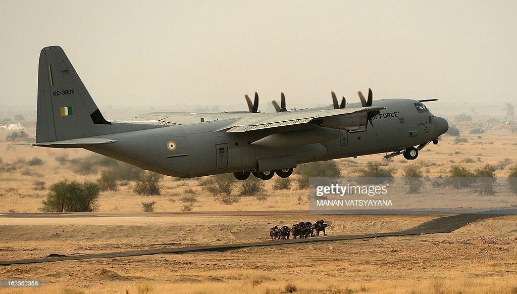 Indian Air Force (IAF) C-130J aircraft takes off after performing an assault landing during the Iron Fist 2013 exercise in Pokhran on February 22, 2013. IAF held the Iron Fist 2013 exrecise to showcase its operational capabilities during day,dusk and night taking out simulated targets with precison laser-guided weaponry. AFP PHOTO/ MANAN VATSYAYANA