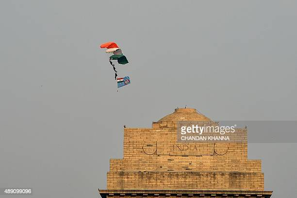 Indian Air Force paratroopers of the Akash Ganga team glide in during rehearsals for Shauryanjali a commemorative exhibition on the Golden Jubilee of...