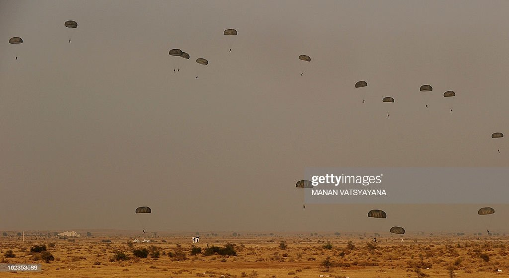 Indian Air Force paratroopers prepare to land during the Iron Fist 2013 in Pokhran on February 22, 2013. IAF held the Iron Fist 2013 exercise to showcase its operational capabilities during day, dusk and night, taking out simulated targets with precison laser-guided weaponry. AFP PHOTO/ MANAN VATSYAYANA