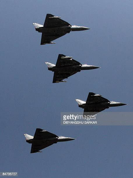 Indian Air Force Tejas LCA fly in formation during the inauguration of Aero India 2009 at the Yelahanka Air Force Station in Bangalore on February 11...