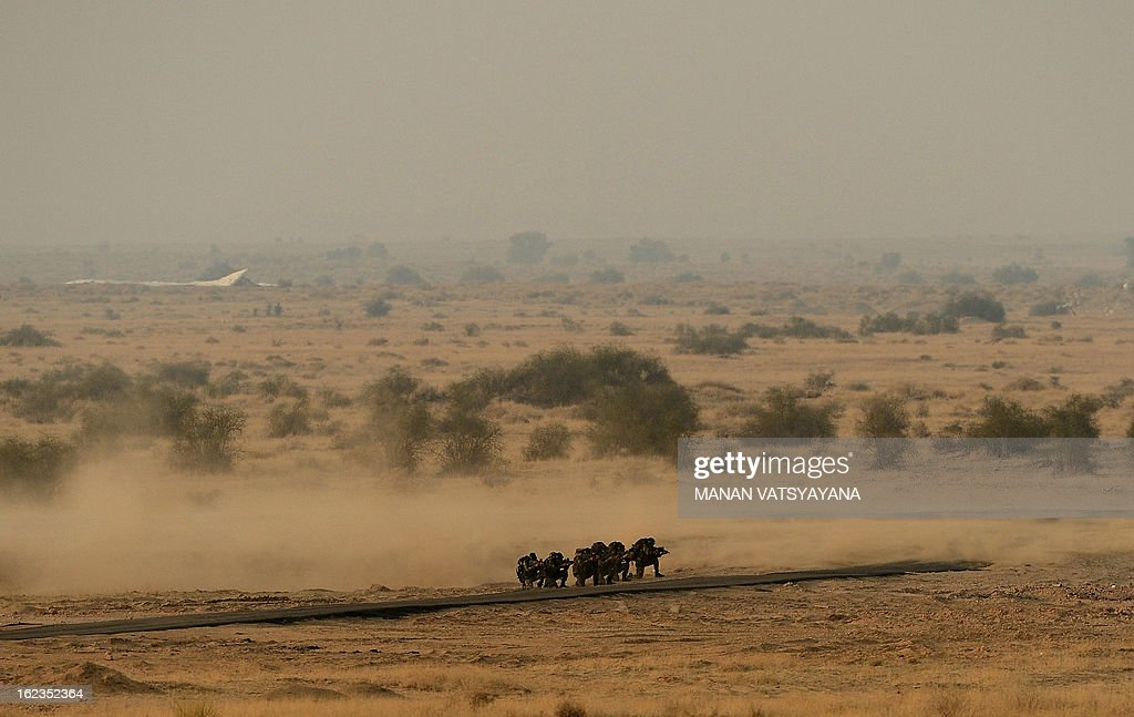 Indian Air Force (IAF) troops take part in the Iron Fist 2013 exercise in Pokhran on February 22, 2013. IAF held the Iron Fist 2013 exrecise to showcase its operational capabilities during day,dusk and night taking out simulated targets with precison laser-guided weaponry.