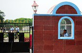 Indian Airforce cadets ride on bicycles as security personel stand guard at the Tambaram Airforce station in Chennai on July 23 2016 India on July 22...