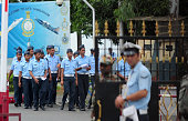 Indian Airforce cadets walk past as security personel stand guard outside Tambaram Airforce station in Chennai on July 23 2016 India on July 22...