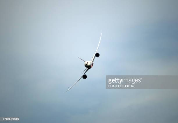 A Indian Airlines Boing 787 Dreamliner flies over Le Bourget airport near Paris on June 18 2013 during the 50th International Paris Air show AFP...