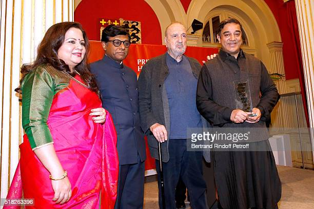 Indian Ambassador to Paris Mohan Kumar his wife Mala Kumar Director JeanClaude Carriere who presents the Price Henri Langlois to Indian actor and...
