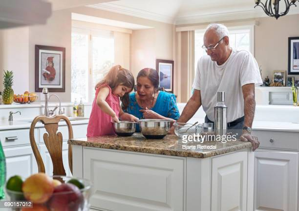 Indian American Family Cooking Together