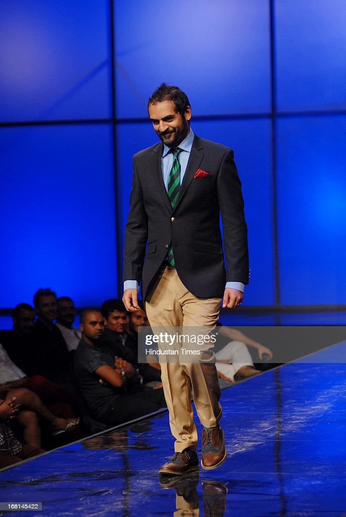 Indian American musician Karsh Kale walks the ramp during the Blackberrys Sharp Night Fashion Show at Mehboob studio, Bandra on May 3, 2013 in Mumbai, India. The Blackberrys Sharp Night is a fashion show organised by Blackberrys to showcase their new Summer/Spring collection.