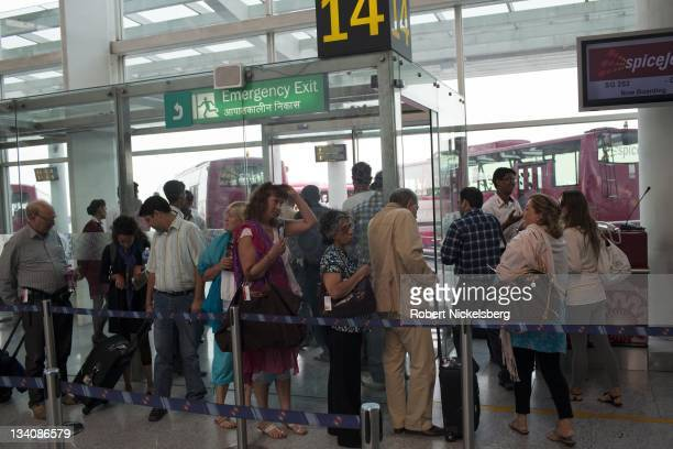Indian and foreign passengers wait for their flight to Goa October 11 2011 in the domestic terminal of the Indira Gandhi International Airport in New...