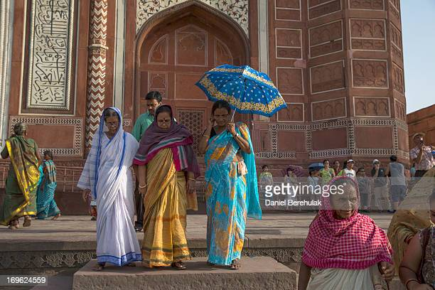 Indian and foreign tourists visit the Taj Mahal on May 29 2013 in Agra India Completed in 1643 the mausoleum was built by the Mughal emperor Shah...