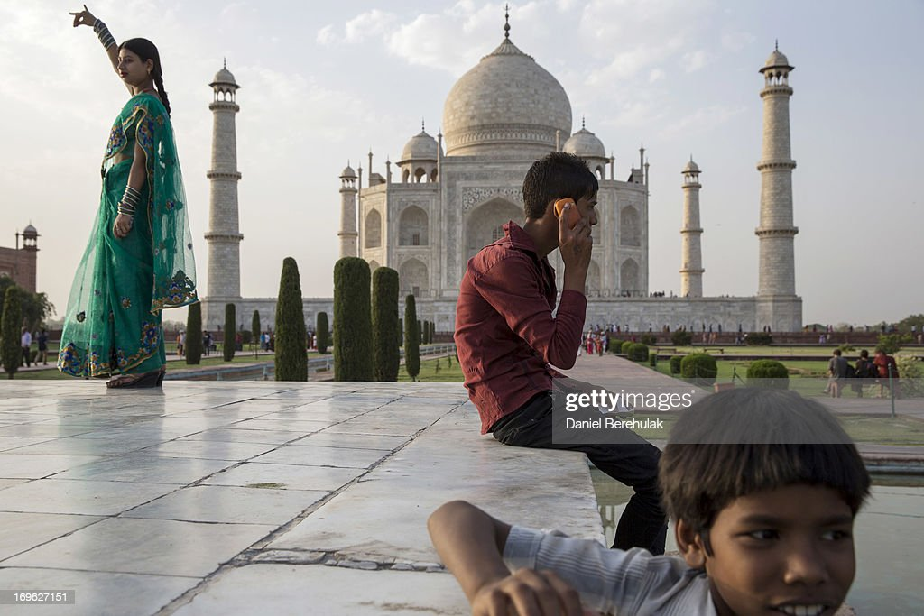 Indian and foreign tourists visit the Taj Mahal on May 29, 2013 in Agra, India. Completed in 1643, the mausoleum was built by the Mughal emperor Shah Jahan in memory of his third wife, Mumtaz Mahal, who is buried there alongside Jahan.