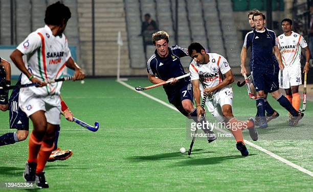 Indian and French player vies for ball during a men's field match between India and France of the FIH London 2012 Olympic Hockey Qualifying...