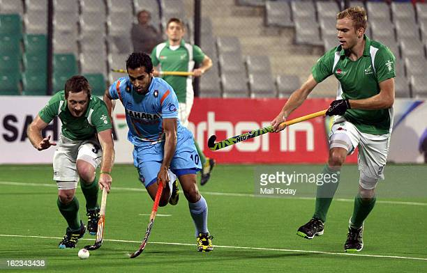 Indian and Ireland players vie for the ball during their FIH Hockey World League Round 2 match at National stadium on Thursday