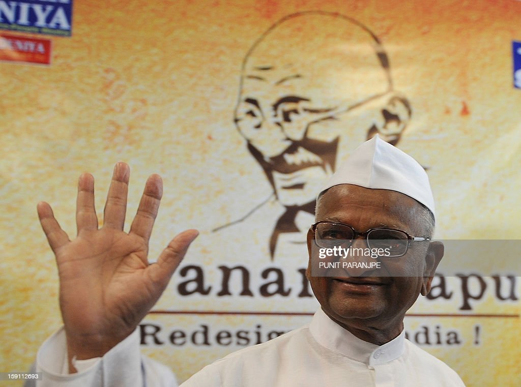 Indian anti-corruption activist Anna Hazare waves to the media during a function for the receipt of personal memorabilia of Mahatma Gandhi at the international airport terminal in Mumbai on January 8, 2013. Gandhi's pair of iconic spectacles, a famous wooden 'charkha' which he personally used, a signed prayer book, several letters and other documents pertaining to Gandhi's life, and 24 other personal memorabilia were auctioned in London on April 17, 2012 and purchased by Indian industrialist Kamal Morarka who handed over the memorabilia to Hazare and his team. The memorabilia will be showcased in a tour around the country.