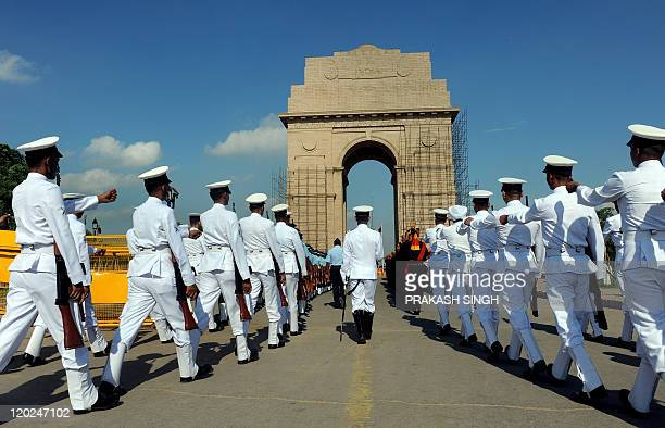 Indian armed forces personnel march at India Gate prior to a tribute ceremony to commemorate eleven years since the victory of the Kargil war in New...