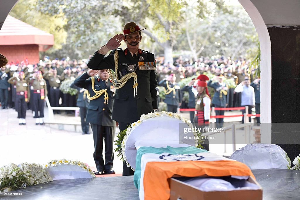 Indian Army Chief Dalbir Singh Suhag paying his last respect to the rescued soldier Lance Naik Hanumanthappa during his funeral ceremony at Brar square crematorium on February 11, 2016 in New Delhi, India. Lance Naik Hanamanthappa Koppad of 19 Madras Regiment was rescued alive on night after being buried under 35 feet of snow for six days. The lone survivor of the February 3 Siachen avalanche that claimed the lives of nine soldiers, breathed his last at the Army RR Hospital in Delhi.