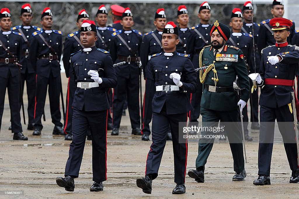 Indian Army Chief General Bikram Singh (2nd R) inspects a guard of honour as chief guest during a graduation ceremony for some 157 Sri Lankan army officers in the island nation's central district town of Diyatalawa on December 22, 2012. General Singh is on a five-day official visit to Sri Lanka. AFP POHOTO/Ishara S