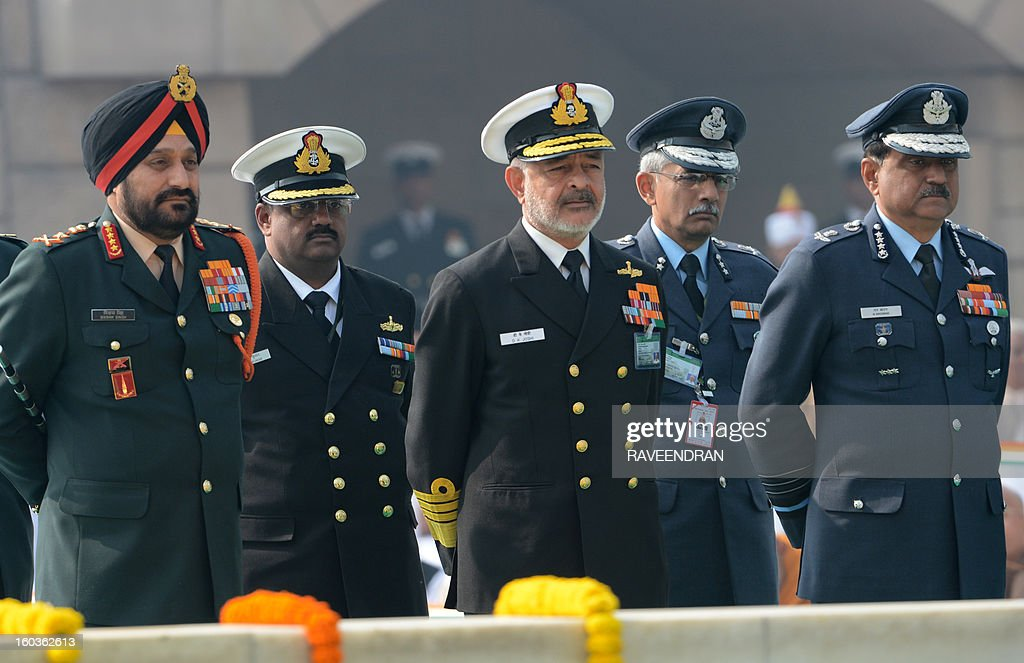 Indian Army Chief General Bikram Singh (L), Navy Chief Admiral Devendra Kumar Joshi (C), and Chief of Air Staff Air Chief Marshal N.A.K. Browne (R) pays homage at Rajghat, the memorial of India's founding father Mahatma Gandhi, on Martyrs Day in New Delhi on January 30, 2013, the 65th anniversary of Gandhi's assassination. Mahatma Gandhi was on the way to a prayer meeting in the Indian capital when he was shot three times in the chest and head on January 30, 1948.