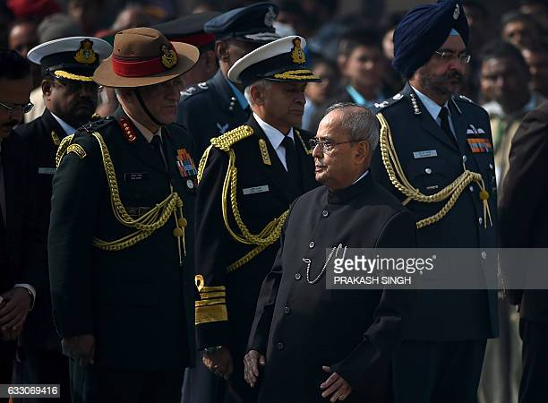 Indian Army Chief Lieutenant General Bipin Rawat Navy Chief Admiral Sunil Lanba and Air Force Chief Air Marshal Birender Singh Dhanoa watch as Indian...