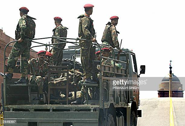 Indian Army commandos stand in a truck as they patrol the road leading to The Presidential Palace in New Delhi 31 August 2003 Indian security forces...