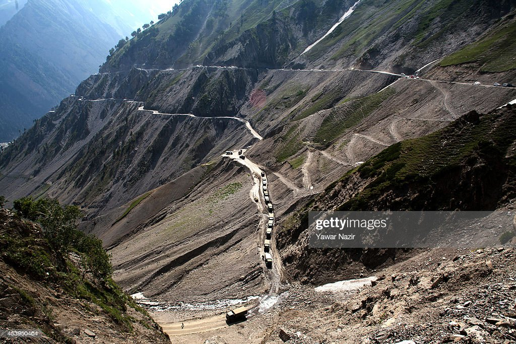 Indian army convoy carrying supply move on a treacherous pass on August 22, 2014 in Zojila, about 108 km (67 miles) east of Zojila, has an impressive location, enclosed by Kashmir valley on one side and Drass valley on the other side and functions as a major link between Ladakh and Kashmir, is considered to be the World's most dangerous pass is located at 3529 meters. The average snow buildup on the rocky Zojila- which is part of the 443 km (275 miles) long Srinagar-Leh highway- normally stays in the level of 15 to 25 meters and is closed for half year. It opens up in late spring and witnesses violent breezes because of the conical shape. Travellers on the pass have to face and withstand snowstorms, fierce air currents, cold and highly dangerous circumstances.