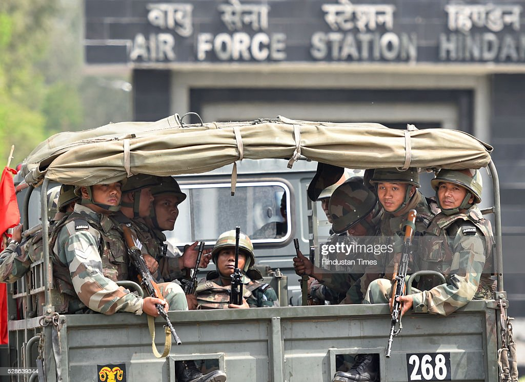 Indian Army jawans waiting in truck as joint search operation being carried on by police and Airforce team at Hindon Airbase after a man was noticed in early hours of the day by the security staff on May 6, 2016 in Ghaziabad, India. During search, the joint team of air force and police personnel nabbed the man named Sonu Jatav, aged 24 roaming under suspicious circumstances. According to police sources he seems to be retarded but was detained for further investigation by agencies.