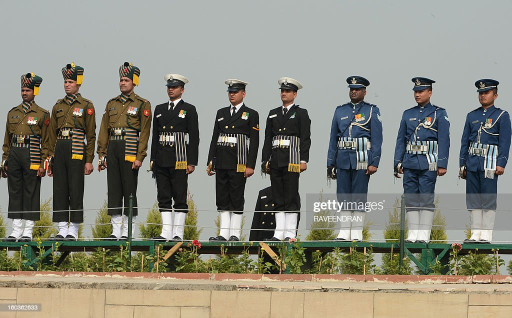 Indian Army, Naval and Air Force soldiers pay homage at Rajghat, the memorial of India's founding father Mahatma Gandhi, on Martyrs Day in New Delhi on January 30, 2013, the 65th anniversary of Gandhi's assassination. Mahatma Gandhi was on the way to a prayer meeting in the Indian capital when he was shot three times in the chest and head on January 30, 1948.