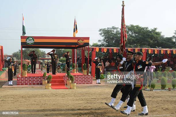 Indian Army officers hold the Nishaan the flag of the regiment as they participate in a ceremonial parade as the 8th Mechanised Infantry celebrated...