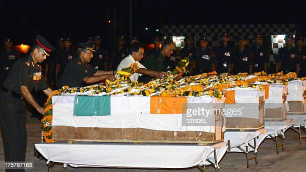 Indian Army officers lay wreaths and pay their respects over the caskets of five soldiers killed in during a crossborder attack in Kashmir following...