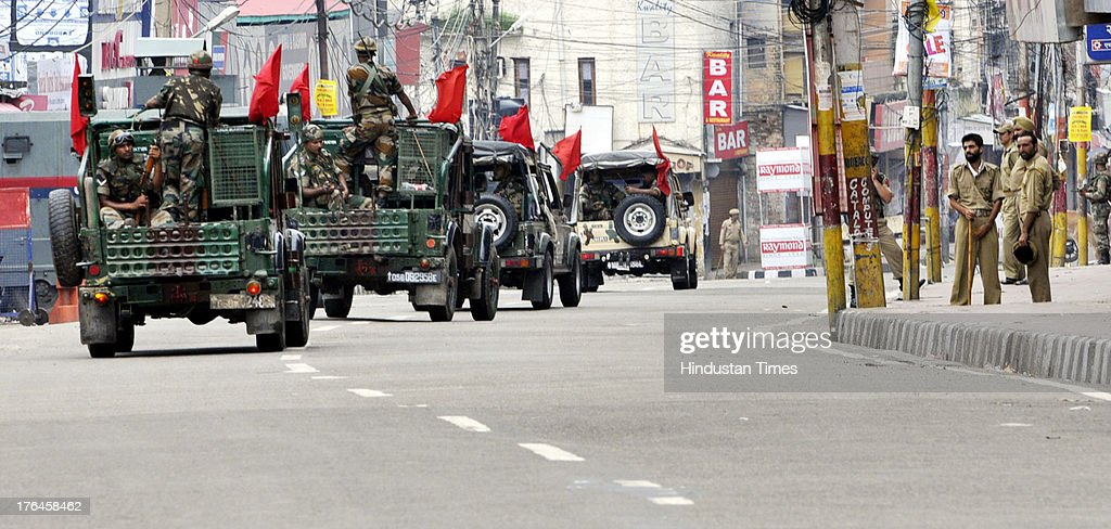 Indian army patrol during a curfew on August 13, 2013 in Jammu, India. Curfew continued in the eight districts of Jammu, Kathua, Samba, Reasi, Udhampur, Rajouri, Doda and Kishtwar districts of Jammu region. Loudspeaker-fitted police vehicles announced in the morning that curfew was in force in these districts and that people should remain indoors. While curfew continued for the fifth day in Kishtwar district where it was imposed on Friday following communal clashes, in other districts it continued for the fourth day on Tuesday. Police arrested 11 people in connection with the communal clashes in Kishtwar.