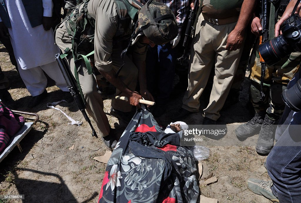 Indian army personal identifies the body of a killed rebel near the gunbattle site in Khonshipora 25 miles west of srinagar on May 27,2016.Two rebels were killed by indian forces during a brief gunfight.