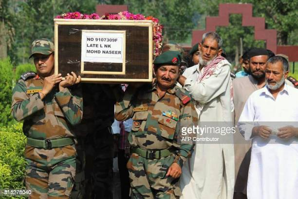 Indian Army personnel and local villagers carry the coffin of slain soldier Lance Naik Mohammed Naseer to his village in Ajout in Poonch district...