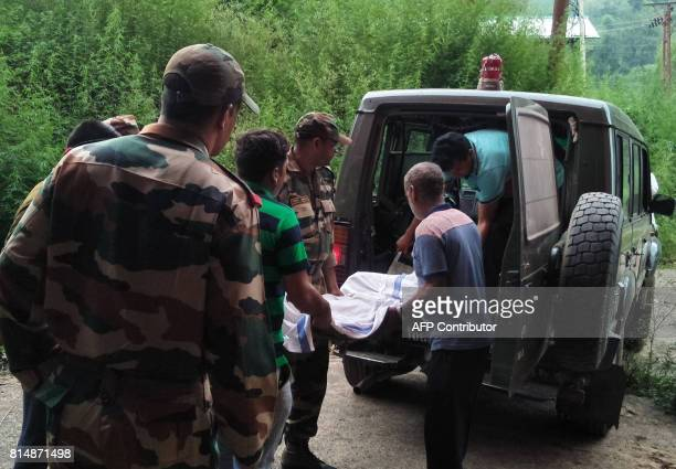 Indian Army personnel and medical workers shift the body of slain soldier Lance Naik Mohammed Naseer to a morgue in Rajouri about 159km from Jammu on...