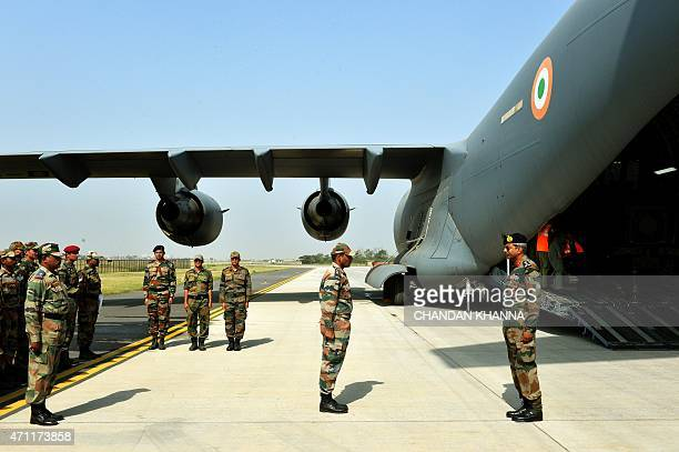 Indian Army personnel on a rescue mission prepare to board an Indian Air Force aircraft containing relief materials to be airlifted to Nepal to...