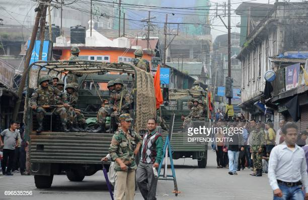 Indian army personnel patrol amid clashes between security personnel and protesters and an indefinte strike called by the Gorkha Janmukti Morcha in...