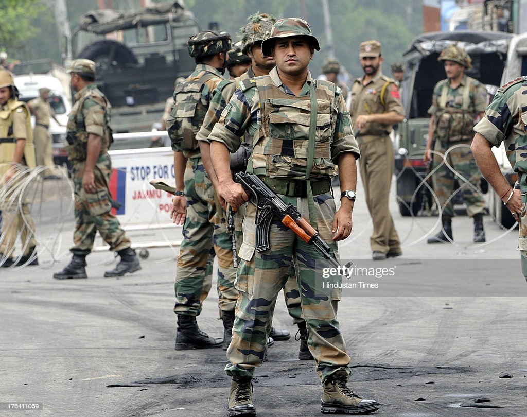 Indian Army personnel patrol during a curfew on August 12, 2013 in Jammu, India. Authorities imposed curfews in seven towns in the Indian portion of Kashmir on Sunday as sporadic clashes between Hindus and Muslims continued for a third day, officials said. Jammu and Kashmir's Home Minister Sajjad Ahmad Kichloo tendered his resignation today amid widespread communal violence in Kishtawar district. Kichloo said his consciousness didn't allow him to head the police department since J&K Chief Minister Omar Abdullah had ordered a judicial probe into the clashes.