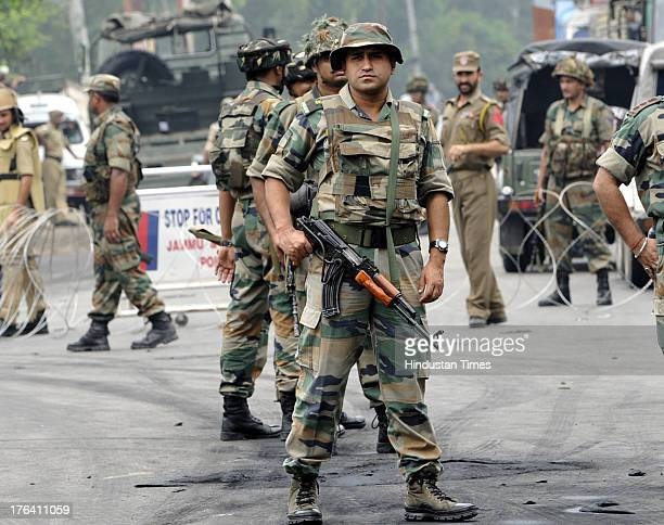 Indian Army personnel patrol during a curfew on August 12 2013 in Jammu India Authorities imposed curfews in seven towns in the Indian portion of...