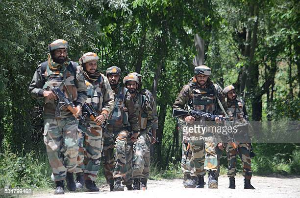 Indian army personnel patrol near the encounter spot in Kunzer some 30 kilometers from Srinagar the summer capital of Kashmir Two militants were...