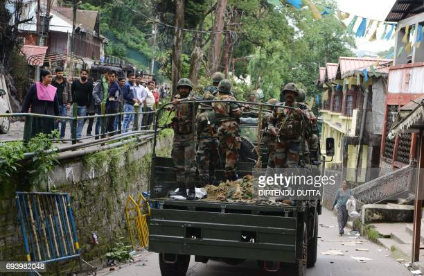 Indian Army personnel patrol the streets atop a vehicle after clashes between police and Gorkha People's Liberation Front supporters in Darjeeling on...