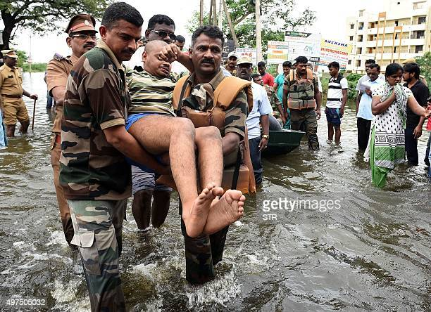 Indian Army personnel rescue floodaffected people during their relief operations in rainhit areas on the outskirts of Chennai on November 17 2015...
