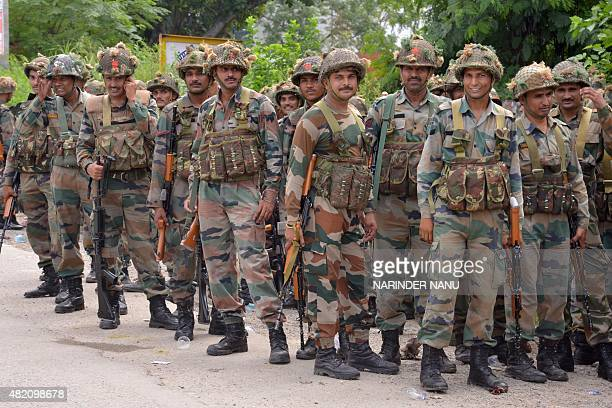 Indian Army personnel stand guard during an encounter with armed attackers at the police station in Dinanagar town in the Gurdaspur district of...