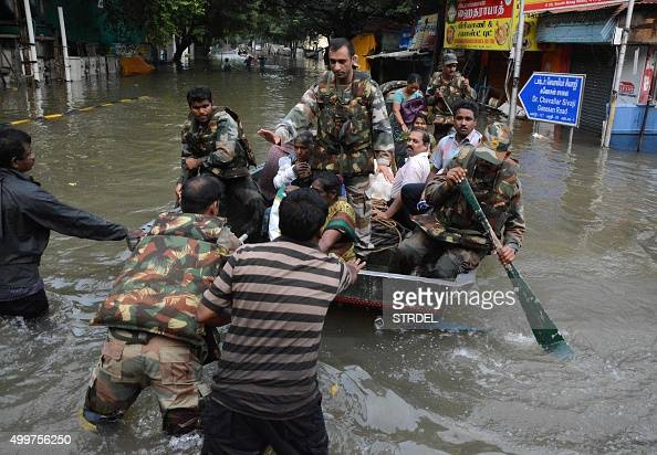 Indian army personnel use a boat to rescue residents from floodwaters in Chennai on December 3 2015 Thousands of rescuers raced to evacuate residents...