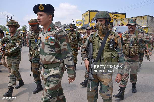 Indian Army personnel walk during an encounter with armed attackers at the police station in Dinanagar town in the Gurdaspur district of Punjab state...