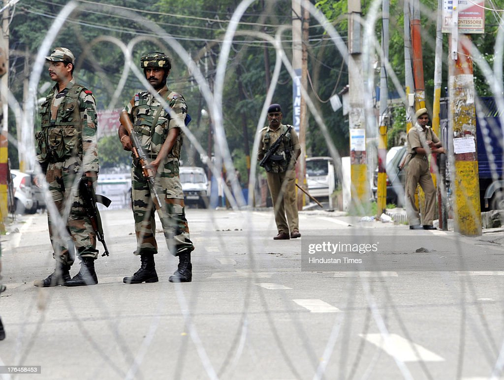 Indian army petrol during a curfew on August 13, 2013 in Jammu, India. Curfew continued in the eight districts of Jammu, Kathua, Samba, Reasi, Udhampur, Rajouri, Doda and Kishtwar districts of Jammu region. Loudspeaker-fitted police vehicles announced in the morning that curfew was in force in these districts and that people should remain indoors. While curfew continued for the fifth day in Kishtwar district where it was imposed on Friday following communal clashes, in other districts it continued for the fourth day on Tuesday. Police arrested 11 people in connection with the communal clashes in Kishtwar.