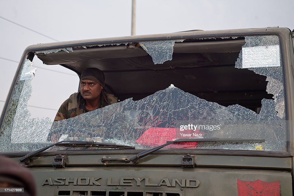 Indian army soldier takes away damaged vehicle which came under the attack of militants on June 24, 2013 in Srinagar, the summer capital of Indian administered Kashmir, India. Suspected militants opened fire on an Indian army convoy on the outskirts of Srinagar, killing at least five and wounding seven others, ahead of Indian Prime Minister Manmohan Singh's visit to the disputed Himalayan region tomorrow. The militants fled from the scene and half an hour later hurled a grenade on Indian paramilitary forces in Barzulla area , some two kilometers away. Hizbul-Mujahideen, the largest guerrilla group fighting Indian rule since 1989, claimed responsibility for today's attack, and had just two days before gunned down two policemen in the heart of Srinagar city.
