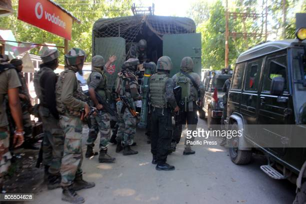 DAILGAM ANANTNAG JANMMU KASHMIR INDIA Indian army soldiers carry explosives near the encounter site at Dailgam area of South Kashmir's Anantnag...