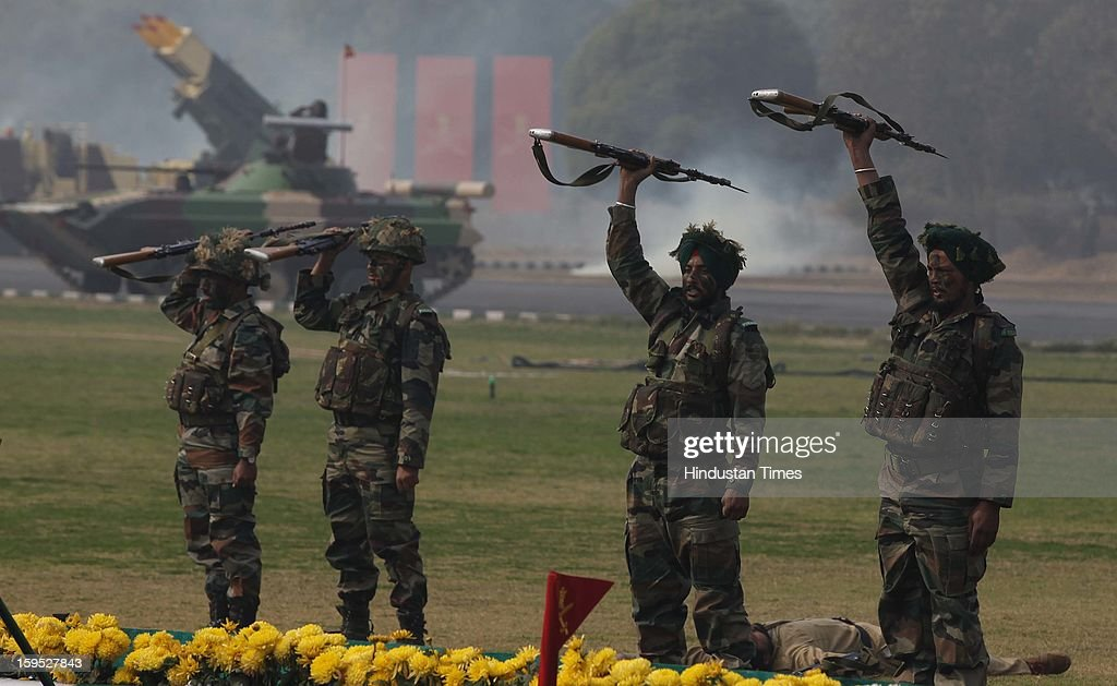 Indian Army soldiers display their combat skills during the Army Day parade At Delhi cant on January 15, 2013 in New Delhi, India. The 65th anniversary of the formation of the Indian national army was celebrated with soldiers from various regiments and artillery units taking part in a parade.